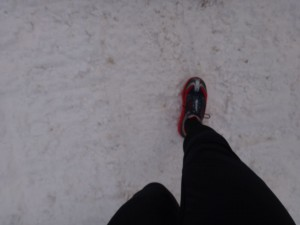 looking down at feet in hoka one one mafate wp spiked running shoes