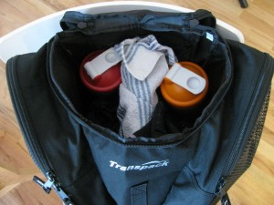 shaker bottles of protein and electrolyte mix in skating bag